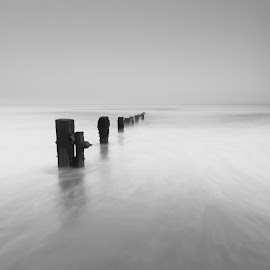 Youghal strand 28-05 B&W by John Holmes - Black & White Landscapes ( minimal, pebbles, beach, contrast, sunset, groynes, sand sea, stones, black and white, long exposure )