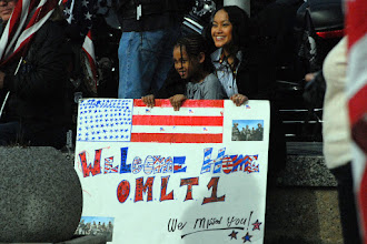 Photo: Family and friends of the OMLT gather in front of the St. Paul, Minn. Armory in anticipation of their Soldier's return.  The twelve Soldiers making up the Operational Mentoring Liaison Team (OMLT) from the Minnesota Army National Guard returned to Minnesota from a one-year deployment to Afghanistan in support of Operation Enduring Freedom on Nov. 6.