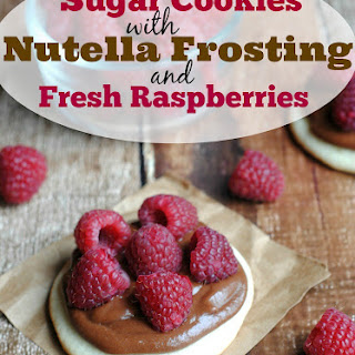 Sugar Cookies with Nutella Frosting and Raspberries