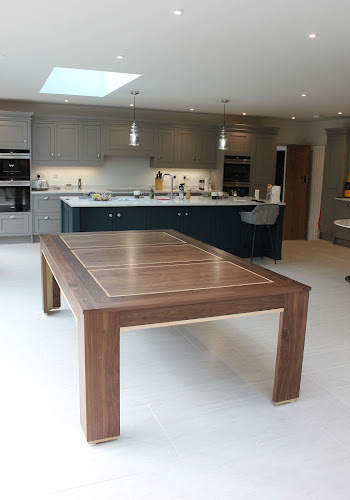 Modern kitchen with contemporary pool dining table