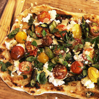 Grilled Pizza with Grilled Tomatoes, Asparagus, Goat Cheese, and Marcona Almonds Recipe