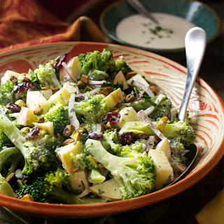 Creamy Broccoli Apple Salad with Pistachios, Cranberries, and Red Onion.