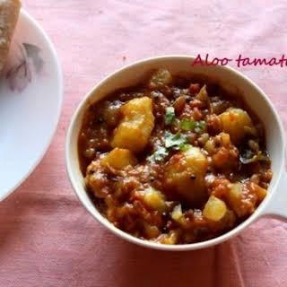 Aloo tamatar (Potato with tomato curry) recipe – no onion no garlic.