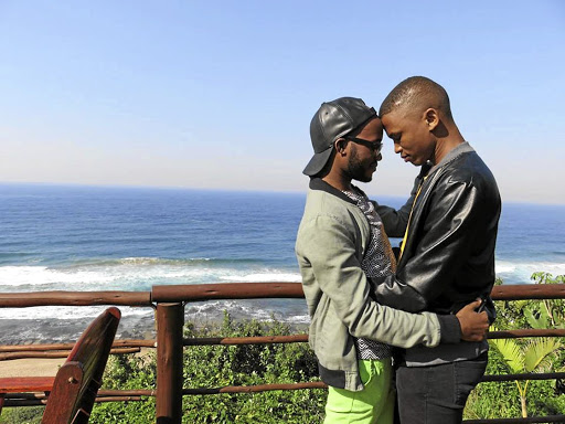 Mosa Seloane and his lover Siya Ngcobo of Glenmore, Durban, share a tender moment. The video of Ngcobo proposing to Seloane went viral on social media, melting hearts in the process.