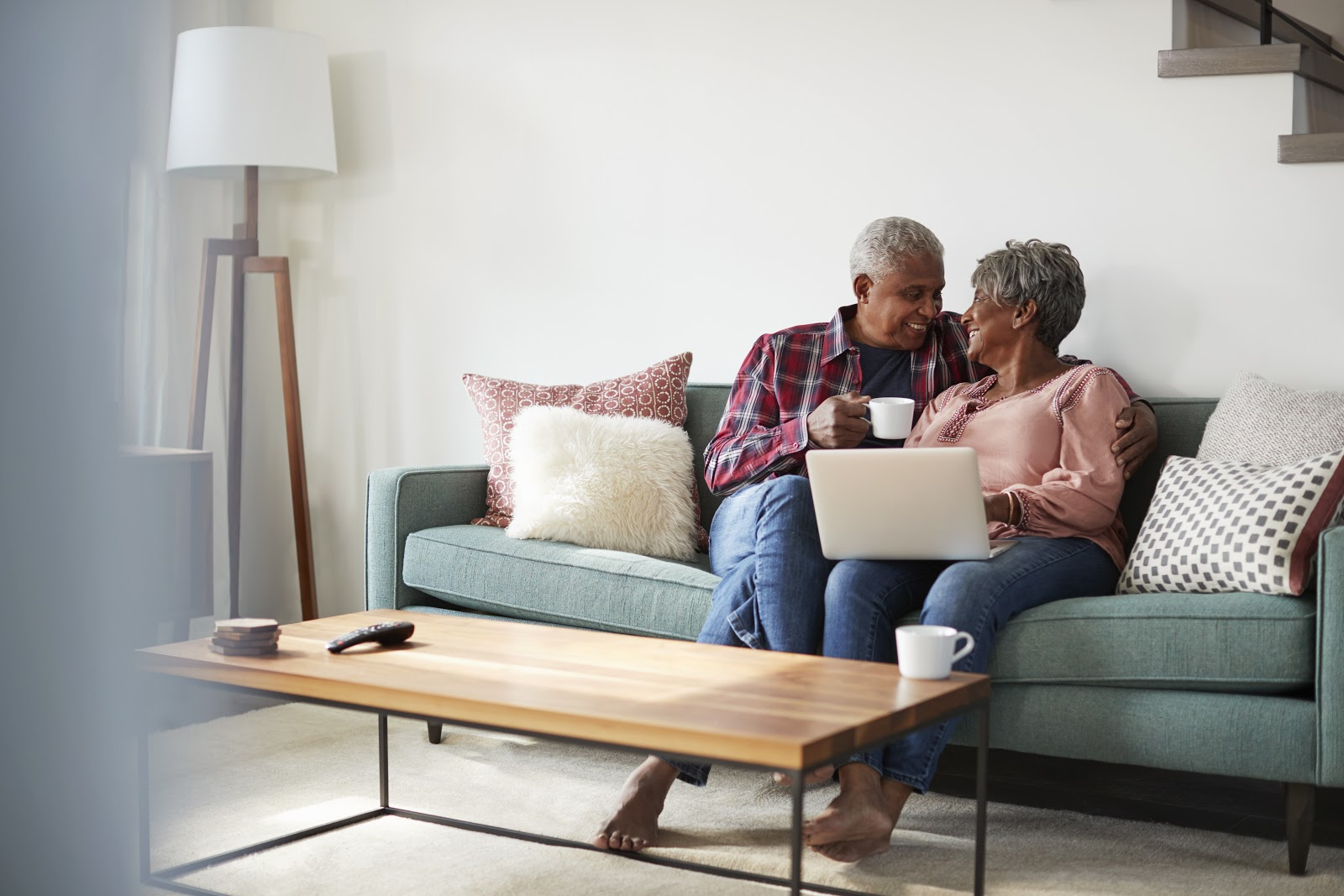 preferred shares: old man and woman sitting in the living room while having coffee