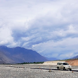 In the middle of vastness by Tridibesh Indu - Landscapes Deserts ( landscapes, pangong, sky, shades, mountains, shyok, cold_desert, black, incredible, clouds, india, nubra, leh, vehicle, road, myriad, hills, desert, ladakh, colours )