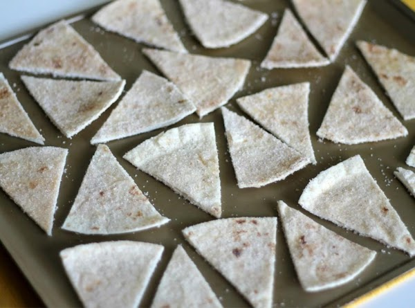 Cut tortillas in small triangles and spray with cooking spray and sprinkle with cinnamin...