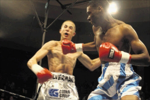 FIRING ON ALL CYLINDERS: Oupa Maimane throws a straight right at Jared Silverman during their lightweight bout at the Nasrec Indoor Arena in Soweto. Maimane won the fight by a majority points decision. Pic: BAFANA MAHLANGU. 15/05/2010. © Sowetan.