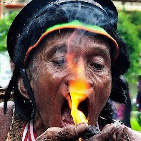 Eating fire by Joel  Pangoe Rihingan - People Portraits of Men (  )