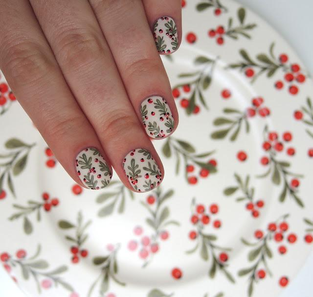Christmas plant nail art with green leaves & red berries on white nails