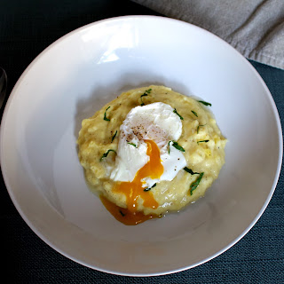 Cheesy Breakfast Mashed Potatoes with a Poached Egg.