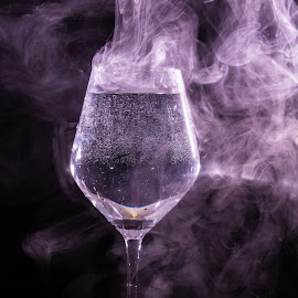 purple water by Andreea Muntean - Food & Drink Alcohol & Drinks ( speedlite, glass, smoke, purple, water )