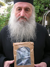 Photo: Fr. Ion holding a photo of Fr. Ioachim's mother, new-martyr Anastasia