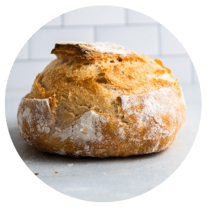 loaf of bread in front of a white background