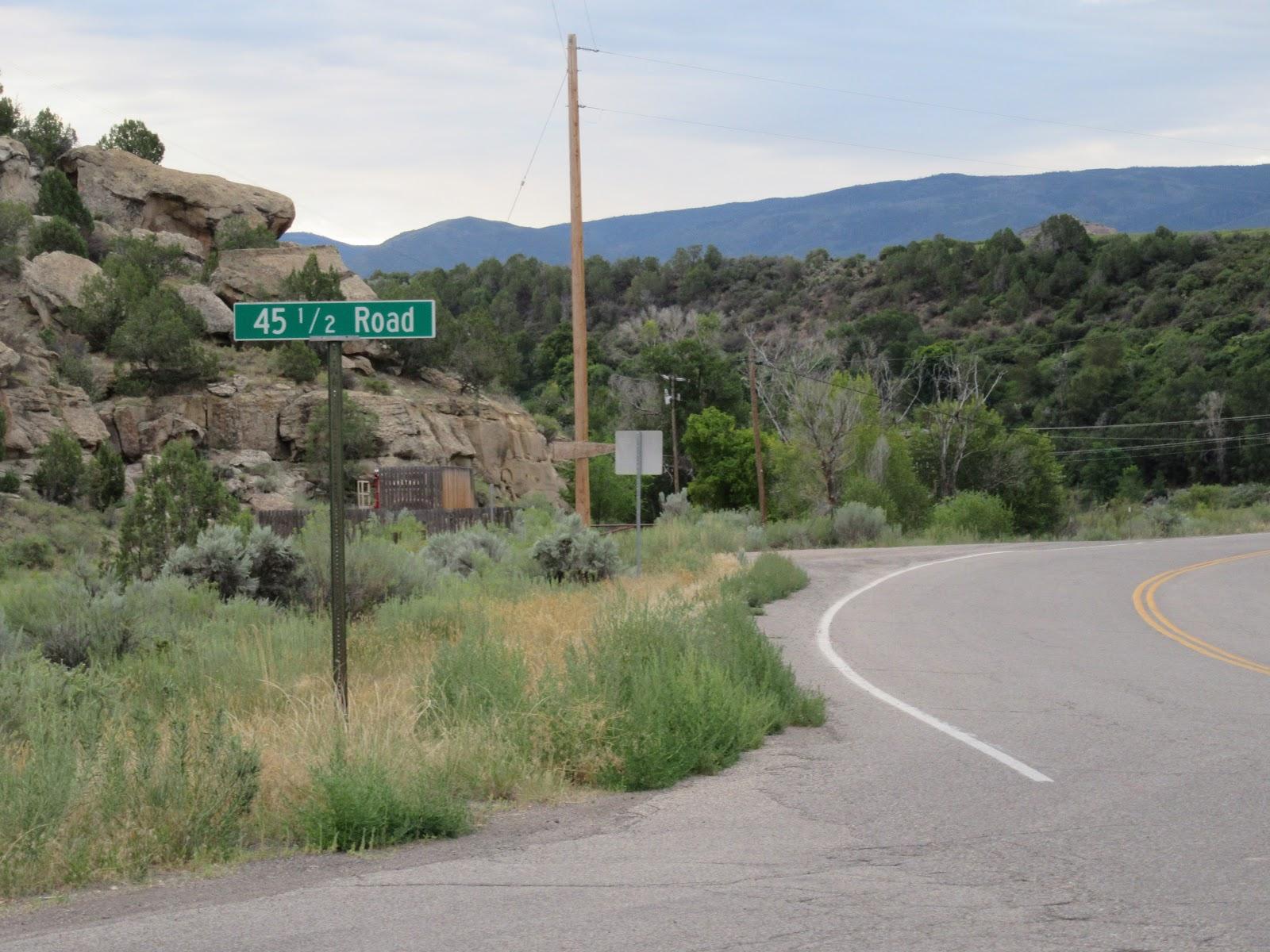 Climbing Grand Mesa North by bike - start of climb - road and road sign - 45 1/2 road