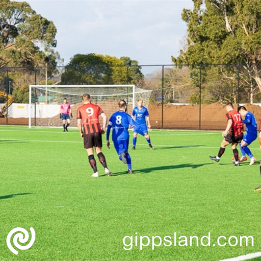 Warragul United in action against Eltham Red Backs on the newly opened synthetic pitch at Baxter Park