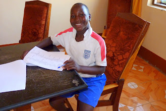 Photo: Bugumya doing his English exam at Bethany