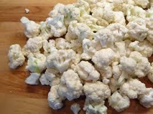 Place cauliflower and pepper pieces in Microwave safe dish  with 1 cup of...