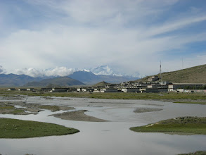 Photo: Tingri and then Cho Oyu beyond the dirty town