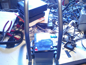 Photo: Here's the frame from taking apart a small air compressor and the battery. My tuner and radio are stacked in the background.,