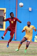 Photo: Daniel Amartey (18) makes the header as Jacques Tuyisenge (9) looks on [Rwanda Vs Ghana AFCON2017 Qualifier, 5 Sep 2015 in Kigali, Rwanda.  Photo © Darren McKinstry 2015