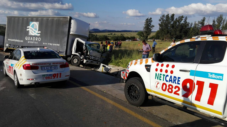 A truck driver is in a critical condition after a stone-throwing incident led to his truck crashing into another vehicle near Lanseria airport.