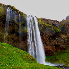 Cloudy Seljalandsfoss by Santford Overton - Landscapes Waterscapes ( landscapes, sky, mountains, waterscapes, nature, light, volcanoes, river, clouds, water, photography )
