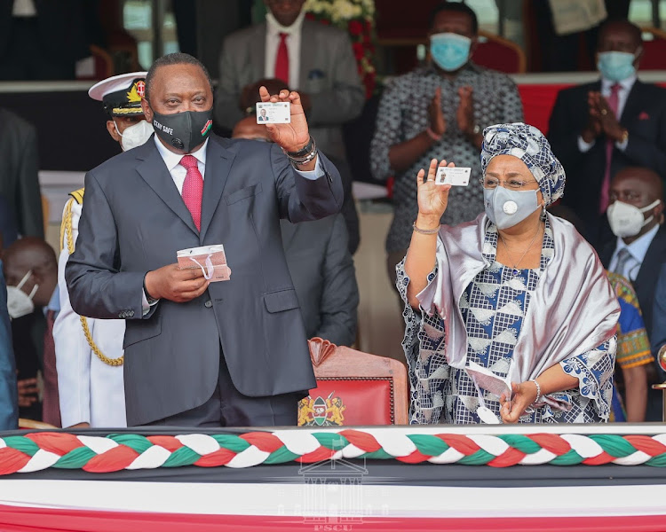 President Uhuru Kenyatta and First Lady Margaret Kenyatta showcasing their Huduma Namba Cards.