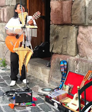Photo: A local entertainer we found very enjoyable while sipping coffee at a wonderful museum in the Plaza de Sanfrancisco in the beautiful city of Cuenca. See the All Photos option to see other shots of interesting honeycomb shop within the museum.