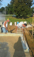 Photo: Mike Kilar placing first block on dugout while Jim Brock (Midwest Masonry) supervises 08-06-2014