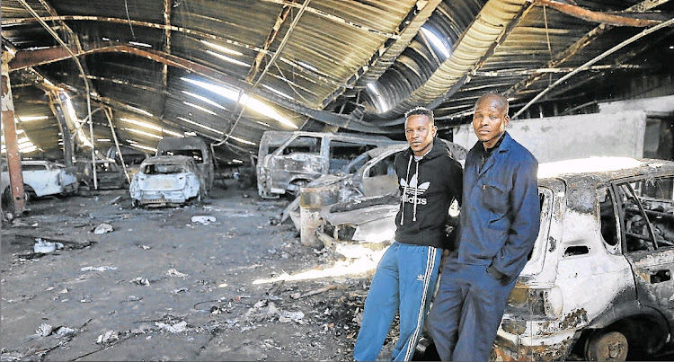 M&K Bodyworks employees Unathi Ngedle and Nyameko Mgqibelo are unsure of their future after the panelbeating firm was hit by fire this week.