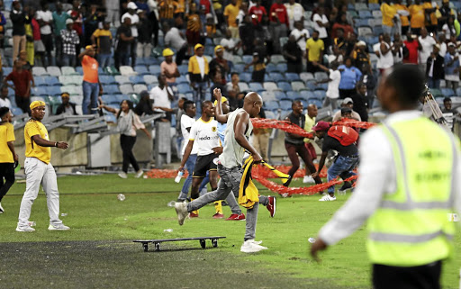 Fans vandalising the stadium during the Nedbank Cup match between Kaizer Chiefs and Free State Stars at Moses Mabhida Stadium in Durban on Saturday.