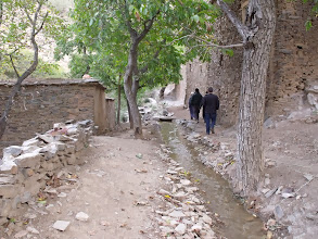 Photo: Walking along the canal bringing water from a spring to the village for irrigation.
