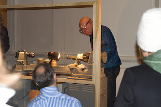 Photo: The votive holder is starting to take shape.  A nice crowd looks on.
