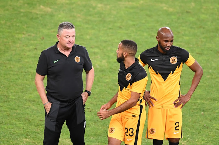 Kaizer Chiefs coach Gavin Hunt speaks to Reeve Frosler and Ramahlwe Mphahlele during the CAF Champions League match between Kaizer Chiefs and Wydad Athletic at FNB Stadium on April 03, 2021 in Johannesburg, South Africa.