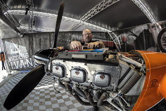 Photo: Nicolas Ivanoff's Technician Martin Barth works on the engine of the plane during the training session for the first stage of the Red Bull Air Race World Championship in Abu Dhabi, United Arab Emirates on February 27, 2014. // Predrag Vuckovic/Red Bull Content Pool // P-20140227-00233 // Usage for editorial use only // Please go to www.redbullcontentpool.com for further information. //