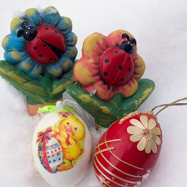 colorful easter decorations on the snow by LADOCKi Elvira - Public Holidays Easter ( holiday, eggs, easter, easter eggs )