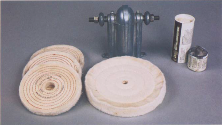 Shown here are arbor heads suitable for making a buffer along with a spiral-sewn wheel (left) and a cushion-sewn wheel (right). Divine Brothers' compounds are shown at the upper right.