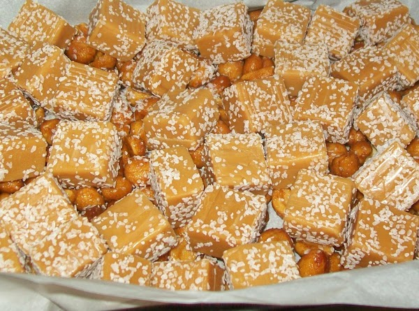 Top the nuts with caramels and then the rest of the nuts.