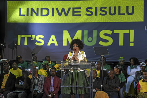 Lindiwe Sisulu speaks   at Walter Sisulu Square in Kliptown, Soweto, against the backdrop of one of her campaign slogans. Picture: Ihsaan Haffejee