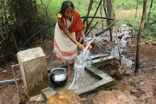 A major reason for the Dongria Kondh's opposition to Vedanta Resource's bauxite mining in the Niyamgiri Mountains in the eastern Indian state of Odisha was that it would destroy their numerous perennial hill streams. Here, a tribal girl washes at a pipe that gushes fresh water 24 hours a day. Credit: Manipadma Jena/IPS