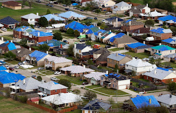 Photo: Hail damaged rooftops in Wylie area are covered with tarps on Thursday, April 14, 2016. (Vernon Bryant/The Dallas Morning News)