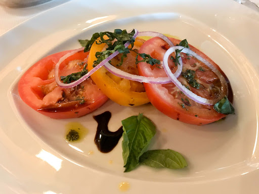 tomato-pinnacle-grill.jpg - A beefsteak tomato appetizer with basil, red onion and pesto, served at Pinnacle Grill on Oosterdam.