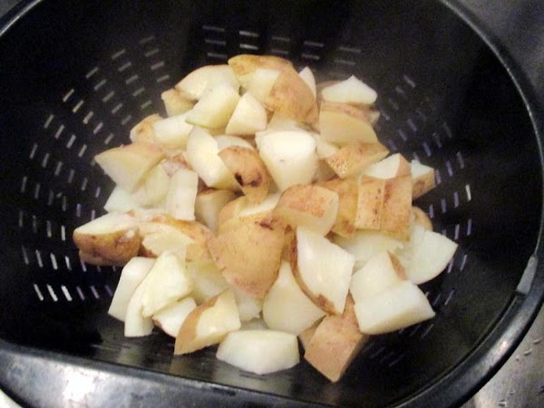 Place prepared potatoes in a saucepan and just cover with water. I added a...