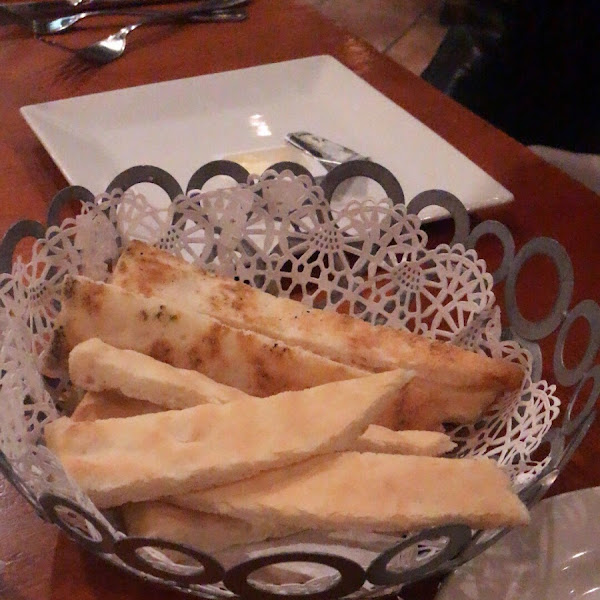 Gluten free bread given before the meal; it was warm and came with butter packets