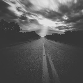 by Chris Timmerman - Landscapes Weather ( black and white, sunset, long exposure, road )