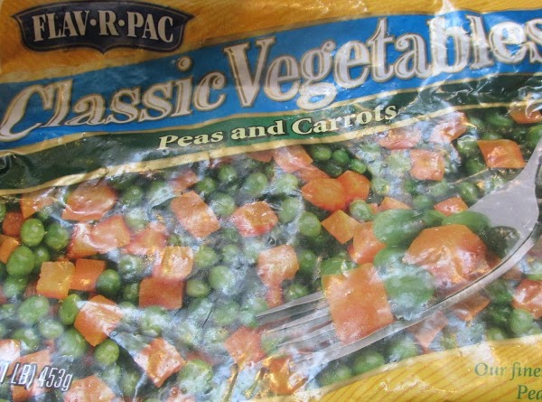 Add the frozen peas & carrots to a medium size bowl and heat in...