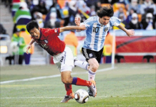 JOHANNESBURG, SOUTH AFRICA, 20100617 - Lionel Messi and Lee Young Pyo fight for the ball during the group phase soccer match between Argentina and South Korea, Fifa World Cup 2010, in Soccer City Stadium, Johannesburg.  PICTURE: BRAM LAMMERS NO RESALE FEE FOR USAGE