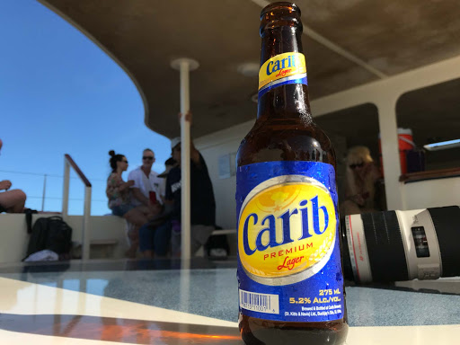 Carib-beer.jpg - Carib beer served during a catamaran outing in the waters of St. Kitts.