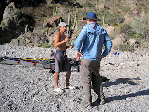 Photo: Bill talking with our fantastic guide Axel, a 28-year-old marine biologist and cook extraordinaire from Mexico City. Axel spoke good English and was very knowledgeable about kayaks, weather and the local paddling and camping conditions. He was also a very good people person.